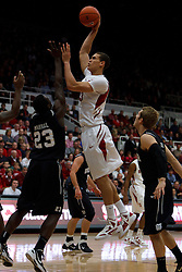 Dec 22, 2011; Stanford CA, USA;  Stanford Cardinal forward Dwight Powell (33) shoots over Butler Bulldogs forward Khyle Marshall (23) during the first half at Maples Pavilion.  Mandatory Credit: Jason O. Watson-US PRESSWIRE