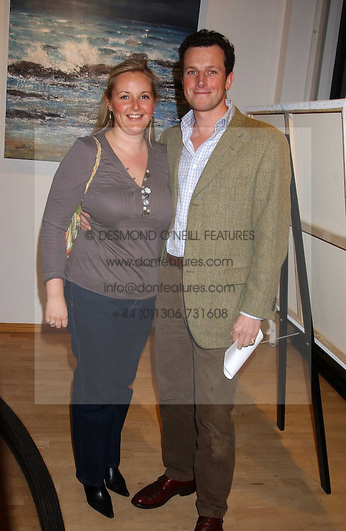 DOMINIC &amp; MARINA EVANS-FREKE at a private view of paintings by George Lewis held at the Air Gallery, 32 Dover Street, London W1 on 5th October 2005.<br />