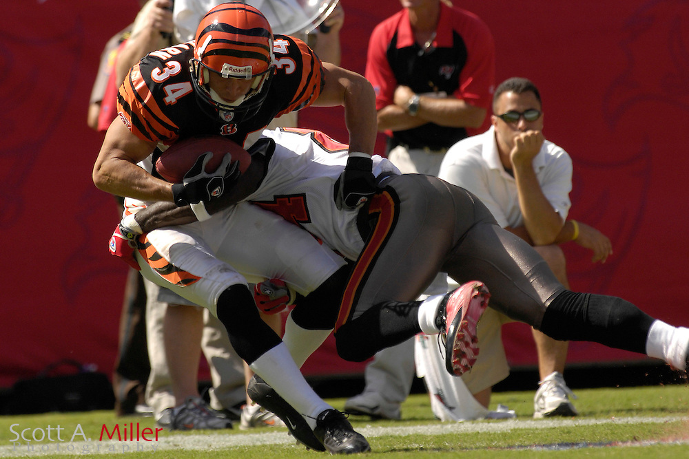 Oct. 15, 2006; Tampa, FL, USA; Cincinnati Bengals defender (34) Kevin Kaesviharn is tackled by Tampa Bay Buccaneers receiver (84) Joey Galloway after Kaesviharn's interception in the first half at Raymond James Stadium. ...©2006 Scott A. Miller