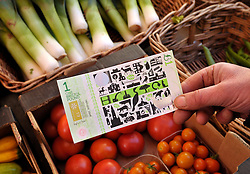 © Licensed to London News Pictures. 19/09/2012. Bristol, UK. Launch of the Bristol Pound, the first local currency to be implemented across a major UK city and already supported by over 300 traders, including electronic payments and supported by the Bristol Credit Union. The notes feature art by local artists and the launch was in Corn Street Bristol, the site of the historic trading area where deals were done on the nails, metal pedestals on the street.  19 September 2012..Photo credit : Simon Chapman/LNP