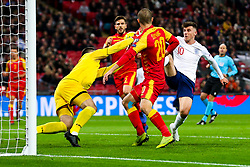 Mason Mount of England is challenged by Milan Mijatovic of Montenegro - Rogan/JMP - 14/11/2019 - FOOTBALL - Wembley Stadium - London, England - England v Montenegro - UEFA Euro 2020 Qualifiers.