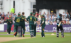Joe Leach of Worcestershire Rapids (R) walks off after being caught out by SJ Mullaney of Notts Outlaws (L) - Mandatory by-line: Jack Phillips/JMP - 09/07/2016 - CRICKET - Trent Bridge - Nottingham, United Kingdom - Nottingham Outlaws v Worcestershire Rapids - Natwest T20 Blast