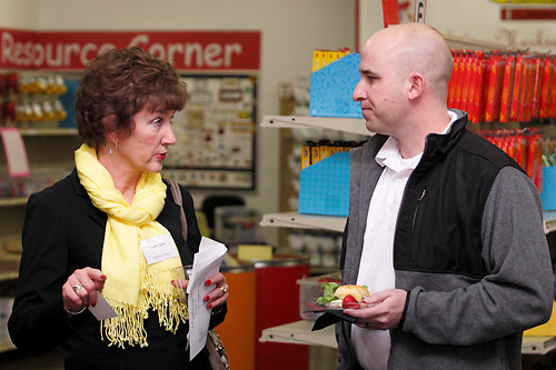 Claudia Curry of Speedpro Imaging (left) during a BBB networking event at Crayons to Classrooms in Dayton, Tuesday, February 28, 2012.