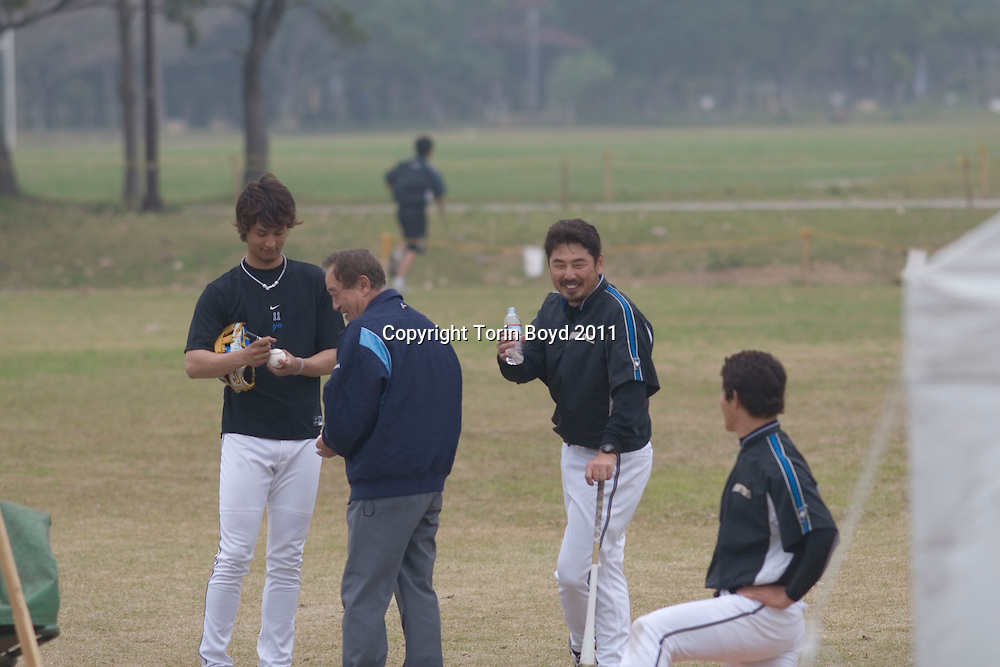 This is Masato Yoshii (center, drinking water), a former Major League pitcher who is retired and is now a pitching coach for the Hokkaido Nippon Ham Fighters of Japan's Pacific League. He is seen here with the 21 year old Japanese pitching sensation Yu Darvish (on left) during Spring training at the Fighters training camp at Nago Stadium in Nago City, Okinawa on February 23, 2008..