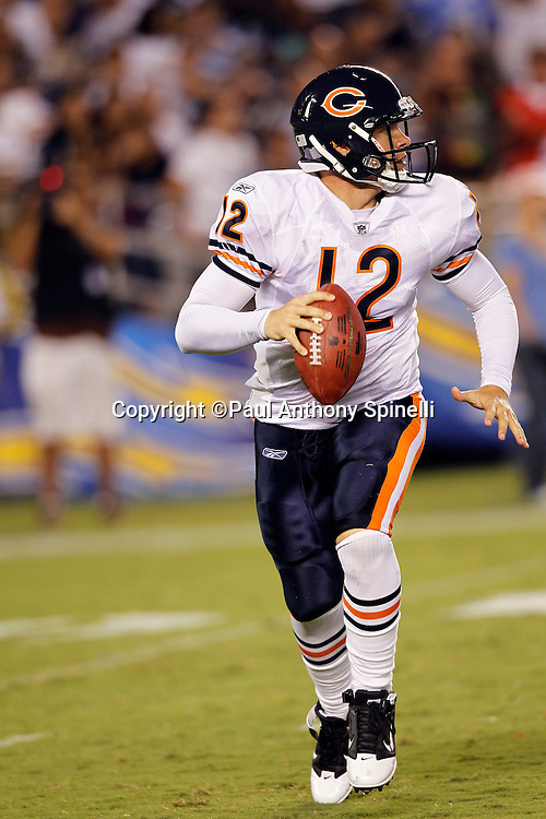 Chicago Bears quarterback Caleb Hanie (12) rolls out while looking to pass during a NFL week 1 preseason football game against the San Diego Chargers, Saturday, August 14, 2010 in San Diego, California. The Chargers won the game 25-10. (©Paul Anthony Spinelli)