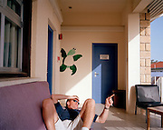Pilot of the Red Arrows, Britain's RAF aerobatic team relaxes in crew Block, mimicking the wall turtle painting.