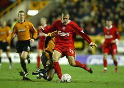 WOLVERHAMPTON, ENGLAND - Wednesday, January 21st, 2004: Liverpool's Bruno Cheyrou is tackled by Wolverhampton Wanderers' Paul Ince during the Premiership match at Molineux. (Pic by David Rawcliffe/Propaganda)