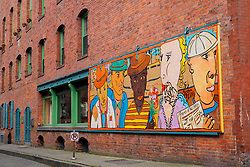North America, United States, Washington, Seattle. A mural at the corner of Post Alley and Yesler Way, in the historic Pioneer Square area of downtown Seattle.