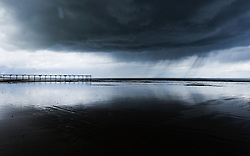 © Licensed to London News Pictures. 19/05/15<br /> <br /> Saltburn, UK. <br /> <br /> Heavy storm clouds gather over the beach and pier at Saltburn by the Sea in Cleveland.<br /> <br /> Photo credit : Ian Forsyth/LNP
