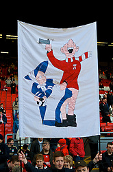 LIVERPOOL, ENGLAND - Saturday, February 6, 2010: A Liverpool supporter's banner featuring the Liverpool Echo's cartoon mascots of a Kopite and Everton's Toffee Lady during the Premiership match at Anfield. The 213th Merseyside Derby. (Photo by: David Rawcliffe/Propaganda)