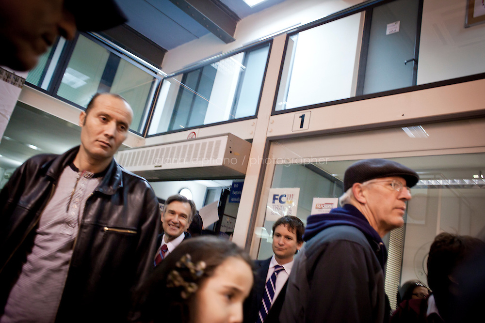 25 February 2011. Valletta, Malta. People arrive at the Customs after stepping down from the ferry that evacuated them from Libya. In the background (left, smiling) is Douglas W. Kmiec, U.S. ambassador in Malta. A U.S.-chartered ferry evacuated Americans and other foreigners out of Libya on Friday and brought them to the Mediterranean island of Malta. The Maria Dolores ferry, after three days of delays, brought over 300 passengers, including at 167 U.S. citizens, away from Libya where Colonel Gaddafi's forces continue to clash with anti-government demonstrators.<br /> <br /> <br /> &copy;2011 Gianni Cipriano<br /> cell. +1 646 465 2168 (USA)<br /> cell. +39 328 567 7923<br /> gianni@giannicipriano.com<br /> www.giannicipriano.com