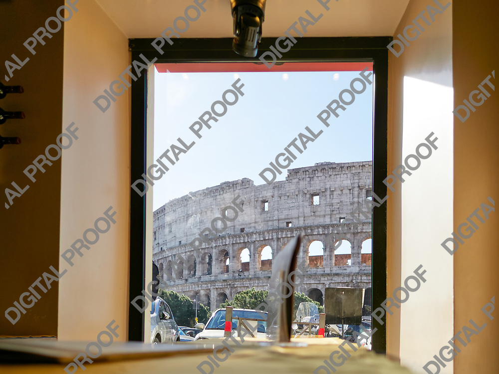 View of the Colosseum from a Cafe during the day