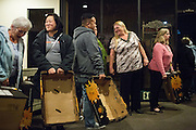 Milpitas Food Pantry volunteers wait to help families receive their donations during a Milpitas Food Pantry event at Lifegate Church in Milpitas, California, on November 25, 2013. (Stan Olszewski/SOSKIphoto)