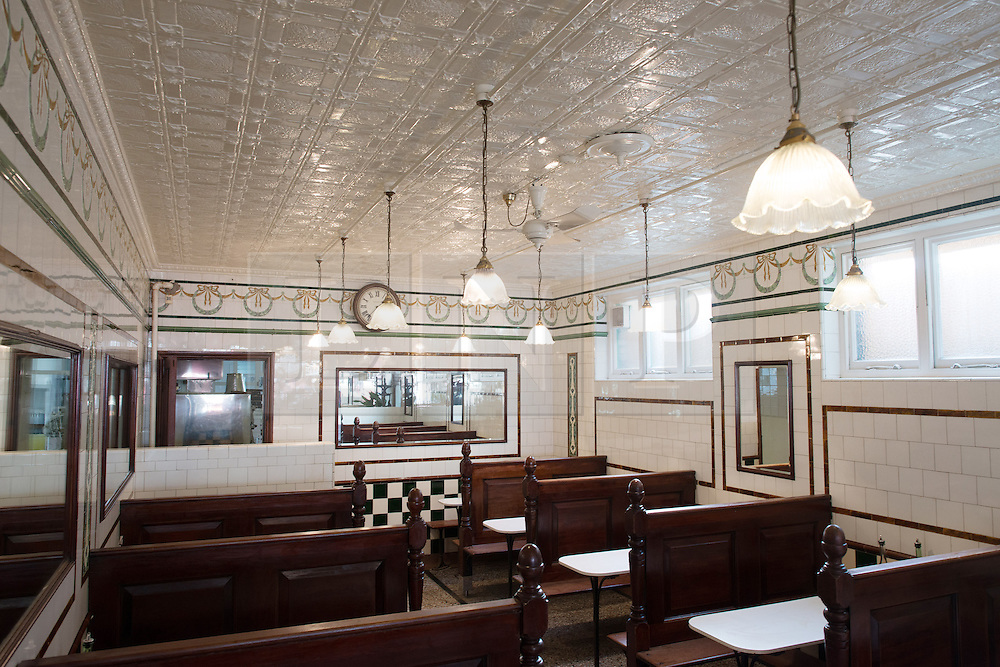 © Licensed to London News Pictures.30/10/2013. London, UK. The interior of the L Manze's Pie and Mash shop which has been listed Grade II by Heritage Minister Ed Vaizey. The Pie and Mash Shop on Walthamstow High Street has been listed due to both its design and historical interest. It embodies the standard features of the London eel, pie and mash shop, from the gilt lettering on the shop-front to the white-tiled interior with mirrors, seating booths and marble counters. And historically illustrates a type of establishment and cuisine that was a staple of early twentieth century working-class life..Photo credit : Peter Kollanyi/LNP
