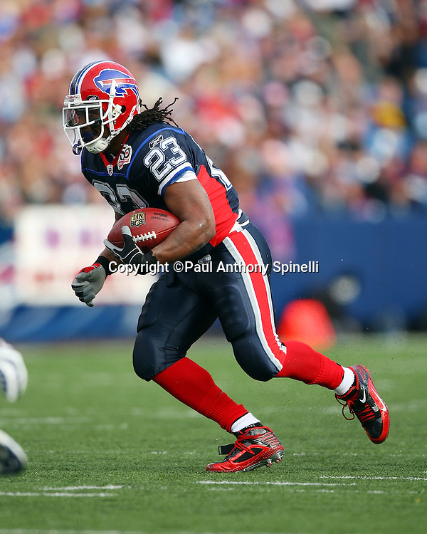 Buffalo Bills running back Marshawn Lynch (23) runs the ball for a 14 yard gain with less than a minute to go in the second quarter during the NFL football game against the Houston Texans, November 1, 2009 in Orchard Park, New York. The Texans won the game 31-10. (©Paul Anthony Spinelli)