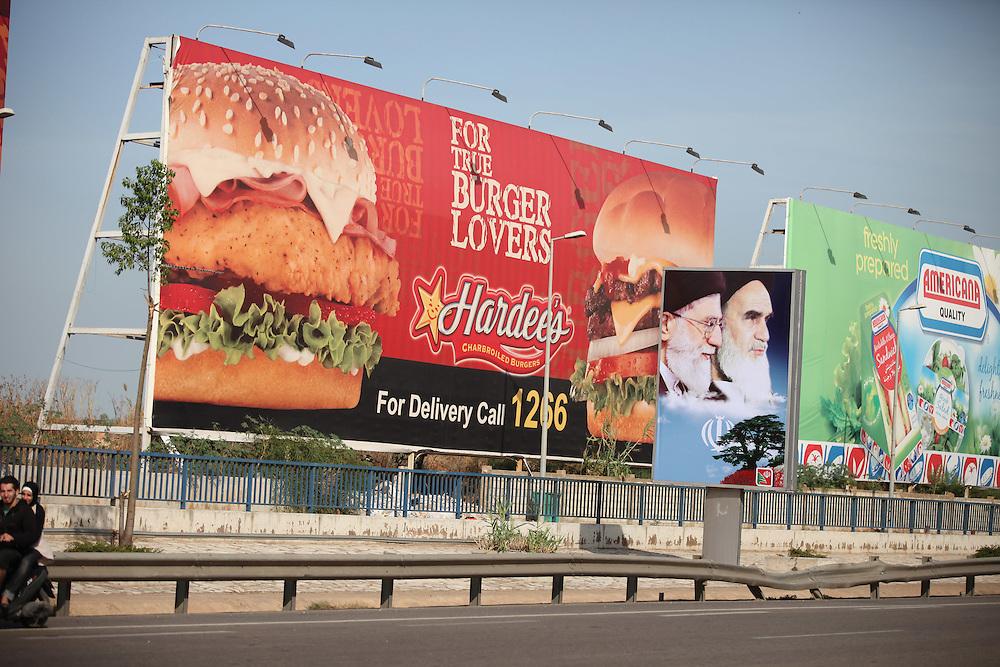 A billboard of Iran's Supreme Leader, Ali Khamenei, and his predecessor, Ayatollah Khomeini.