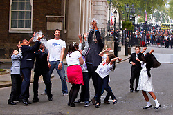 LONDON, UK  29/04/2011. The Royal Wedding of HRH Prince William to Kate Middleton. Prime minister David Cameron and his wife Samatha host a Royal Wedding Street Party outside Number 10 Downing Street. Young and old guests from a range of charities enjoyed cakes, party games including tug of war, catching water bombs and face painting.  Photo credit should read CLIFF HIDE/LNP. Please see special instructions. © under license to London News Pictures