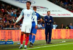 England Manager Gareth Southgate looks on at Dele Alli of England - Mandatory by-line: Robbie Stephenson/JMP - 04/09/2017 - FOOTBALL - Wembley Stadium - London, United Kingdom - England v Slovakia - 2018 FIFA World Cup Qualifier