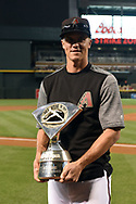 Apr 22, 2017; Phoenix, AZ, USA; Arizona Diamondbacks starting pitcher Zack Greinke (21) with his 2016 NL Wilson Defensive Player of the Year Award during a special pregame ceremony prior to the MLB game at Chase Field. Mandatory Credit: Jennifer Stewart-USA TODAY Sports