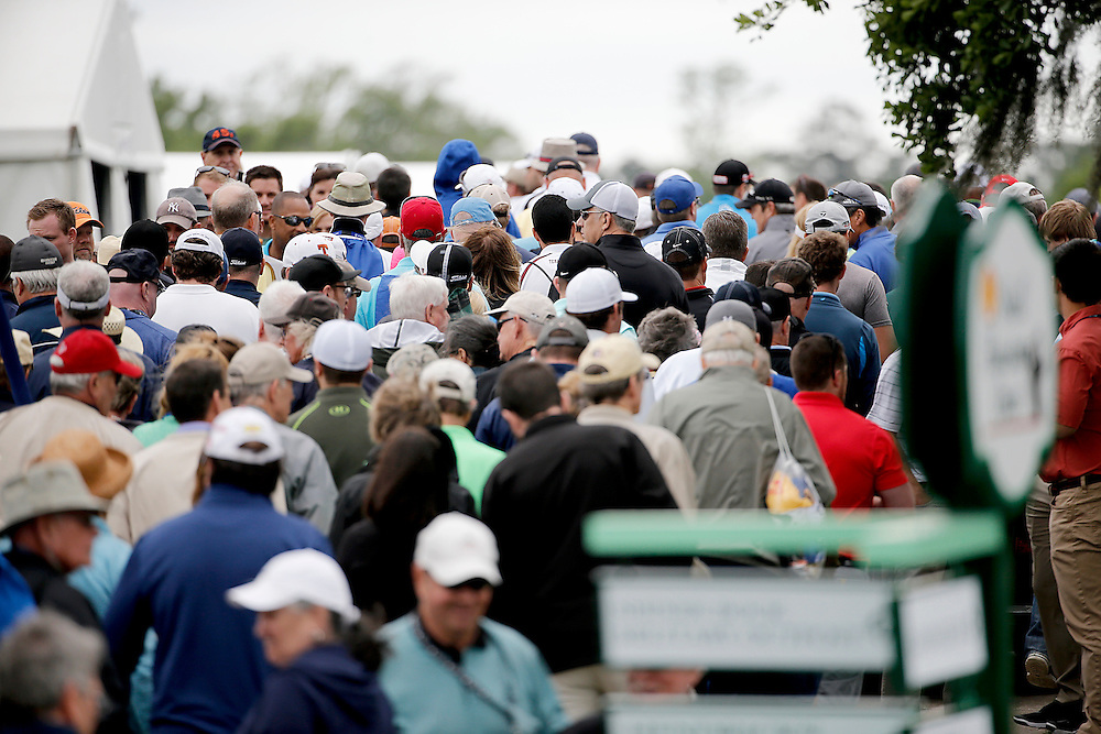 A crowd gathers behind hole #1 waiting for golfers to pass in their golf carts during the second round of the Shell Houston Open golf tournament at the Golf Club of Houston on , Friday, April 1, 2016, in Humble, Texas.  (Photo: Thomas B. Shea/For the Chronicle)