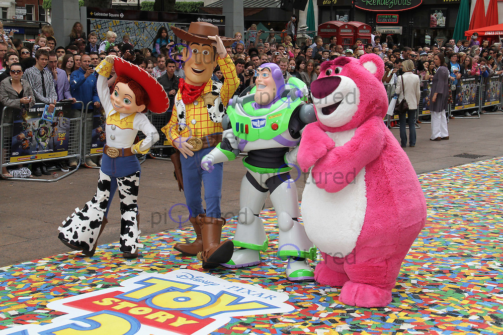 Jessie; Woody; Buzz Lightyear; Lot's-O-Huggin' Bear Toy Story 3 UK Premiere held at the Empire Cinema, Leicester Square, London, UK, 18 July 2010: For piQtured Sales contact: Ian@Piqtured.com +44(0)791 626 2580 (Picture by Richard Goldschmidt/Piqtured)