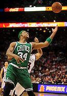 Jan. 28, 2011; Phoenix, AZ, USA; Boston Celtics forward Paul Pierce (34) reaches for a rebound against the Phoenix Suns at the US Airways Center. The Suns defeated the Celtics 88-71.  Mandatory Credit: Jennifer Stewart-US PRESSWIRE