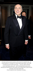 Conservative party leader IAIN DUNCAN-SMITH Mp, at a reception in London on 23rd February 2003.	PHK 358