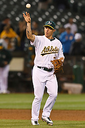 OAKLAND, CA - AUGUST 02: Brandon Inge #7 of the Oakland Athletics throws a baseball after the game against the Toronto Blue Jays at O.co Coliseum on August 2, 2012 in Oakland, California. The Oakland Athletics defeated the Toronto Blue Jays 4-1. (Photo by Jason O. Watson/Getty Images) *** Local Caption *** Brandon Inge