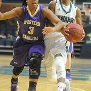 UNCW's Kelva Atkins drives on Western Carolina's Kyia Hough Saturday November 29, 2014 at Trask Coliseum in Wilmington, N.C. (Jason A. Frizzelle)