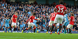MANCHESTER, ENGLAND - Sunday, November 2, 2014: Manchester City's Sergio Aguero is fouled by Manchester United's Marouane Fellaini but no penalty was awarded during the Premier League match at the City of Manchester Stadium. (Pic by David Rawcliffe/Propaganda)