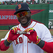 BOSTON, MA - APRIL 4:  David Ortiz #34 of the Boston Red Sox shows of his 2004, 2007 and 2013 championship rings along with a ring honoring his 2013 World Series MVP selection during a ceremony honoring the 2013 World Series Champion Boston Red Sox before the start of a game against the Milwaukee Brewers at Fenway Park on April 4, 3014 in Boston, Masschusetts.  (Photo by Michael Ivins/Boston Red Sox/Getty Images) *** Local Caption ***David Ortiz