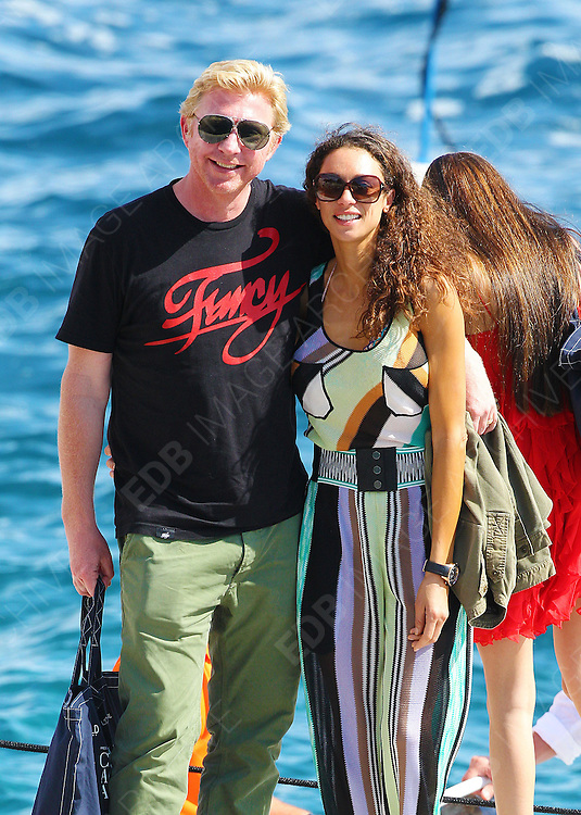 23.MAY.2012. ANTIBES<br /> <br /> BORIS BECKER AND HIS WIFE LILLY BECKER GETTING OFF A BOAT AT EDEN ROCK HOTEL<br /> <br /> BYLINE: EDBIMAGEARCHIVE.CO.UK<br /> <br /> *THIS IMAGE IS STRICTLY FOR UK NEWSPAPERS AND MAGAZINES ONLY*<br /> *FOR WORLD WIDE SALES AND WEB USE PLEASE CONTACT EDBIMAGEARCHIVE - 0208 954 5968*