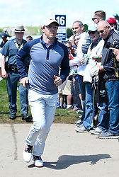 May 15, 2019 - Bethpage, New York, United States - Rory McIlroy walks off the 16th green during a practice round at the 101st PGA Championship at Bethpage Black. (Credit Image: © Debby Wong/ZUMA Wire)