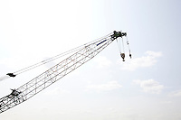Close-up view of crane against sky