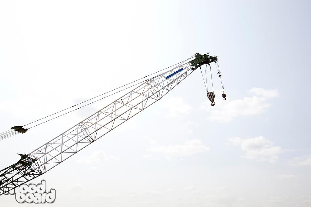 Close-up view of crane against sky