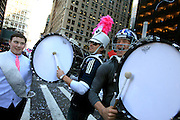 Giants Kicker Lawrence Tynes and punter Steve Weatherford, right, jumped off their float and joined in with one of the marching bands. They marched several blocks druming for the crowd during a ticker-tape parade in honor of the Super Bowl XLVI Champions New York Giants in New York City.