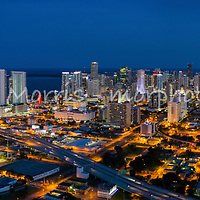 Panoramic aerial view of downtown Miami at twilight looking south featuring the Overtown district in the foreground.  This version is watermarked, contact us to license and clean.