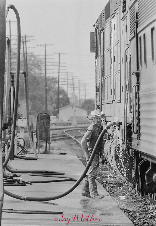 The Amtrak Floridian passenger train that operated between Chicago, Illinois and Miami, Florida ceased operation in 1979.  It was the last passenger train that serviced Louisville. Kentucky as well.  These photographs document the final days for the workers in the Chicago Yards, the Amtrak employees aboard the train, an engineer,, W.C. Roddy, that drove the train between Louisville and Bowling Green, KY and the passengers who enjoyed riding the rails.<br /> <br /> Pictured:  The Floridian engine gets it's water tanks refilled in Wildwood, Florida.