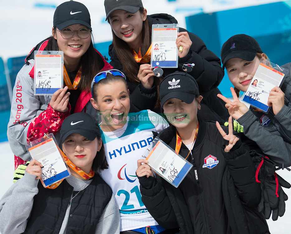March 17, 2018 - Pyeongchang, South Korea - Oksana Masters of the US poses for photos with volunteers following her gold medal finish in the Cross Country 5km sitting event Saturday, March 17, 2018 at the Alpensia Biathlon Center at the Pyeongchang Winter Paralympic Games. Photo by Mark Reis (Credit Image: © Mark Reis via ZUMA Wire)