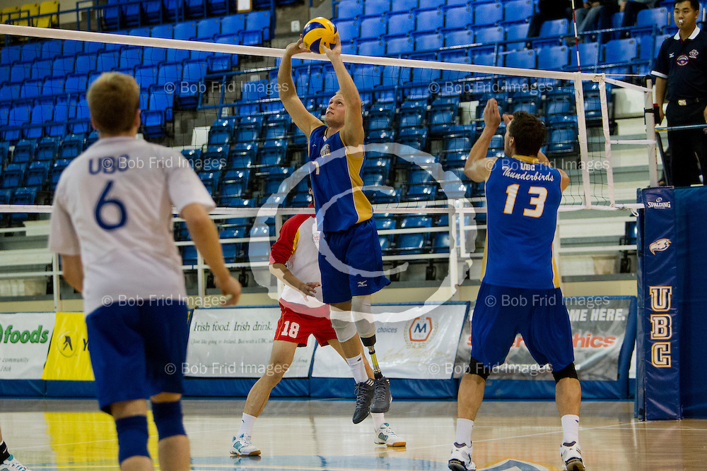 10 October 2012:  Action during a Men's Volleyball game between the University of British Columbia Thunderbirds and Fudan University from China at War Memorial Gymnasium, University of British Columbia, Vancouver, BC, Canada.  Final Score:  UBC 3 Fudan 0   ****(Photo by Bob Frid/UBC Athletics  2012 All Rights Reserved****)