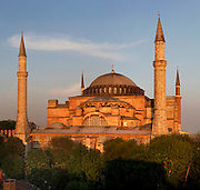 General view of Hagia Sophia, 532-37, by Isidore of Miletus and Anthemius of Tralles, Istanbul, Turkey, at sunset. Hagia Sophia, The Church of the Holy Wisdom, has been a  Byzantine church and an Ottoman mosque and is now a museum. The current building, the third on the site, commissioned by Emperor Justinian I, is a very fine example of Byzantine architecture. The historical areas of the city were declared a UNESCO World Heritage Site in 1985. Picture by Manuel Cohen.