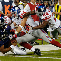 11 August 2006:  The Baltimore Ravens Steve McNair (9) scrambles 6 yards for a touchdown in the first quarter as the New York Giants Corey Webster (23), linebacker Chase Blackburn (54) and Gibril Wilson (28) try to bring him down in a pre-season game won by the Giants 17-16 at M&T Bank Stadium in Baltimore, Md. .