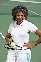Female tennis player on court, portrait