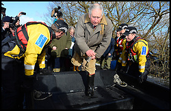 Prince Charles gets on a boat to go and visits Flood Victims on the Somerset Levels, South West England. Members of the community have been cut off by the floods for most of 2014. Tuesday, 4th February 2014. Picture by Andrew Parsons / i-Images