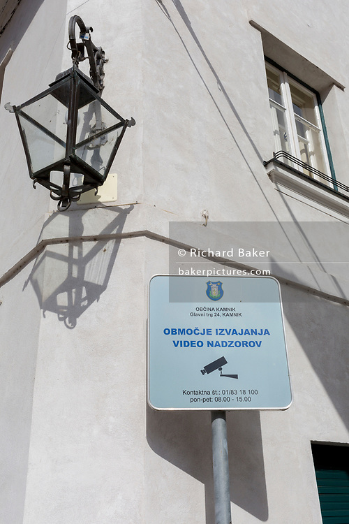 A sign in Slovenian saying that video recording is in operation, on 26th June 2018, in Kamnik, Slovenia.