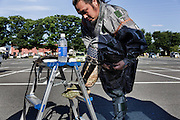 Soma, Fukushima prefecture, July 25 2015 - Kazuhiko ITO is getting dressed before the Sunday race.<br /> The Soma nomaoi is said to be a 1000-year-old traditional festival. It was held in 2011, a few months after the nuclear disaster, but only a few local horses were available.