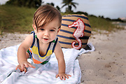 Lucas as he make his way from the beach blanket.