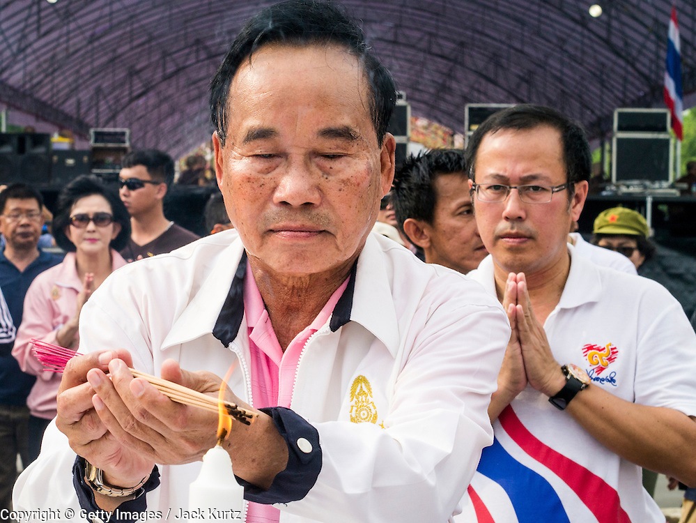 "24 NOVEMBER 2012 - BANGKOK, THAILAND: Gen Boonlert ""Seh Ai"" Kaewprasit, leader of Pritak Siam and organizer of the anti-government rally, prays during a Brahmin blessing ceremony before a large anti government, pro-monarchy, protest  on November 24, 2012 in Bangkok, Thailand. The Siam Pitak group, which sponsored the protest, cited alleged government corruption and anti-monarchist elements within the ruling party as grounds for the protest. Police used tear gas and baton charges againt protesters.       PHOTO BY JACK KURTZ"