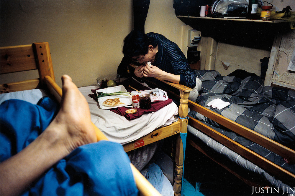 France, Paris, 05-2003..A clandestine Chinese immigrant eats at a safe house in Paris. He is part of a new wave of immigrants from China?s northeast, home to millions of former cradle-to-grave factory workers laid off by closures. ..