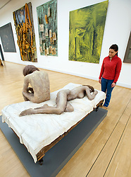 Sculpture by Kurt Trampedach called Morning. Group of Woman and Man, one lying and one sitting on a bed at Statens Museum for Kunst or Royal Museum of Fine Arts in Copenhagen Denmark